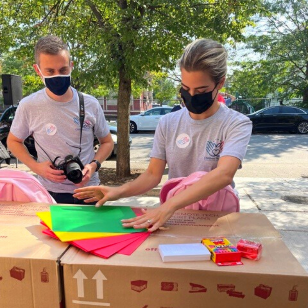 two cff team members organize supplies